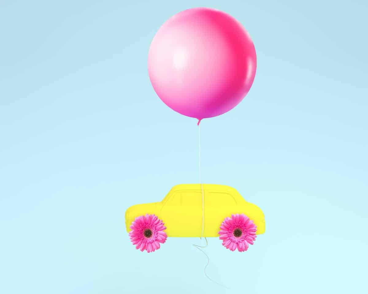 Flower layout wheel and car yellow with pink balloon floating on