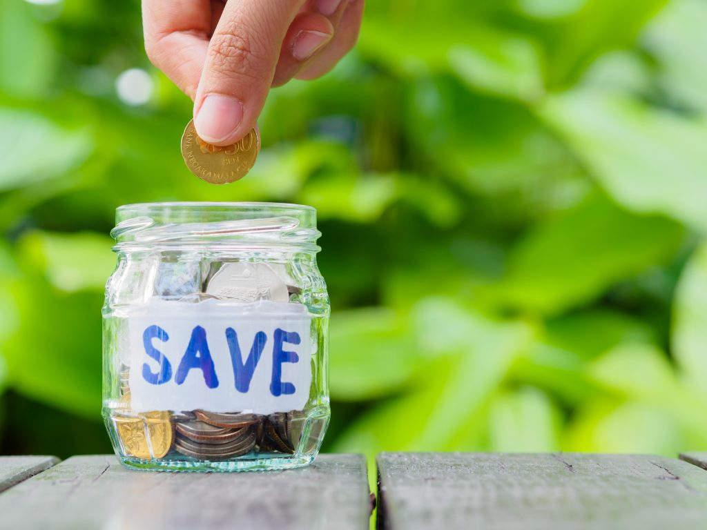 saving money challenge, personal finance, frugal living, saving money, abstract-money-saving-hand-hold-put-coin-glass-jar-coins, money challenges, save more money