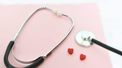 Black stethoscope or phonendoscope on a pink background.World health day.Medicine concept. Medical clinic, education concept. Selective focus. Space for tex.medical flatlay.