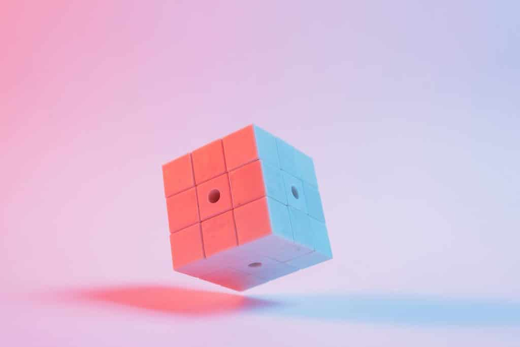 close-up-3d-puzzle-cube-pink-background